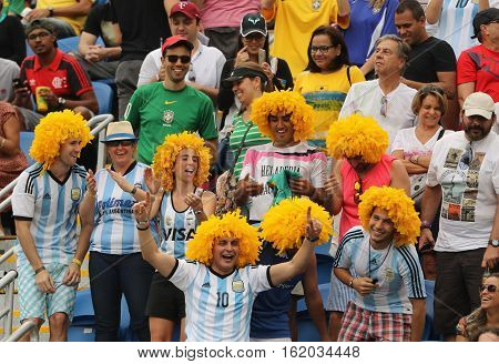 RIO DE JANEIRO, BRAZIL - AUGUST 7, 2016: Argentinian fans support Grand Slam champion Juan Martin Del Potro of Argentina during men's singles tennis match of the Rio 2016 Olympic Games
