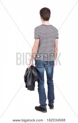 Back view of man in jeans. Standing young guy. Rear view people collection.  backside view of person.  Isolated over white background. guy in striped shirt standing and holding a jacket in his hand.