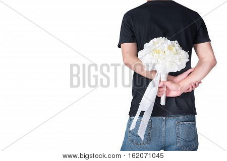 Back view of man hiding white rose bouquet in his back isolated on white background