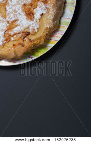 photon picture of cake on the plate you can write in white letters the recipe of your Apple pie or any of Durga lettering on a black background