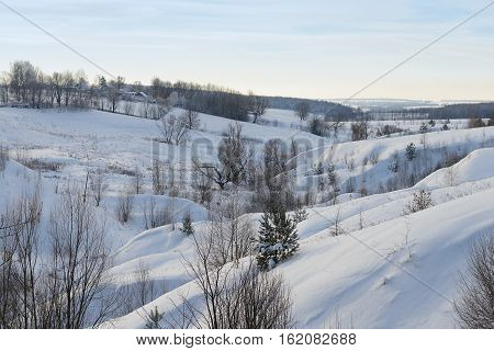 winter landscape with ravines and residential buildings