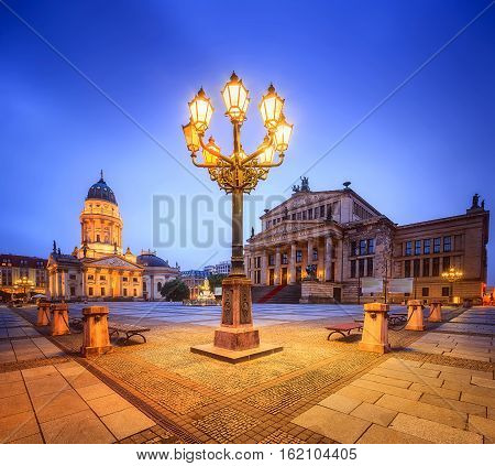 Night view of Gendarmenmarkt square with Berlin Concert Hall and German Cathedral
