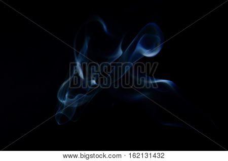 Blue abstract creaturelike smoke art plume on a black background