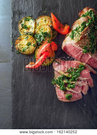 Roast Beef dinner with roasted zucchini, pepper and salsa verde.