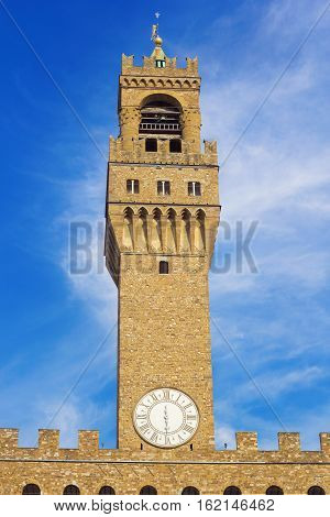 Clock tower of Palazzo Vecchio building in Florence Italy