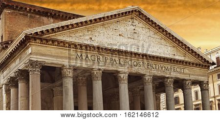 Ancient building of Pantheon in Rome over yellow sunset sky Italy. Pantheon is very popular among tourists.