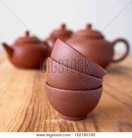 Stackable of chineese cups on wood table
