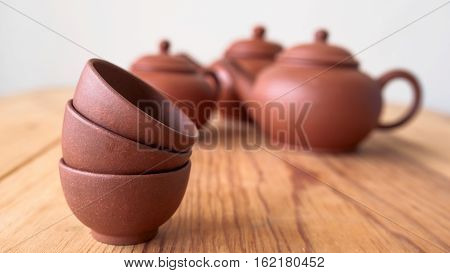 Stackable of chineese cups on spruce wood table