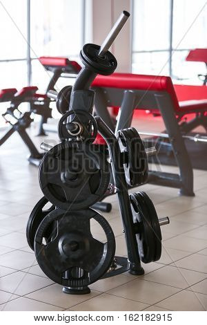 Rack with different weight plates in gym