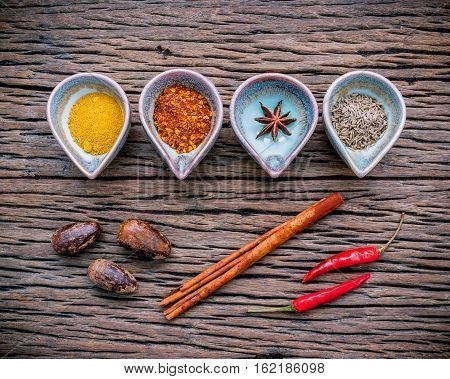 Various Herbs And Spices In Ceramic Bowl . Food And Cuisine Ingredients On Rustic Wooden  Background
