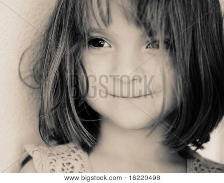 Beautiful little girl with delightful big brown eyes,