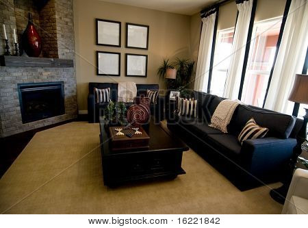 Beautiful large modern living room with large windows and fire place.