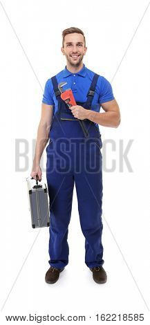 Plumber in blue uniform with screw-wrench and tool box isolated on white