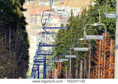 Modern ropeway at resort near forest