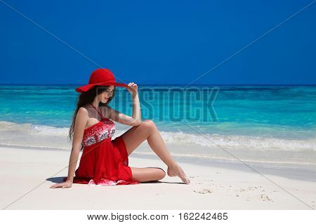 Beautiful Carefree Woman In Hat Enjoying On Exotic Sea, Brunette Relax On Tropical Beach At Summer H