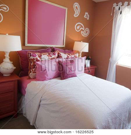 Attractive fun bright modern bedroom for young girls.
