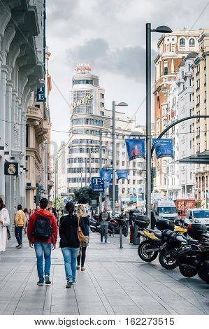 Madrid Spain - September 14 2016: People walking in Gran Via in Madrid. It is an ornate and upscale shopping street located in central Madrid. It is known as the Spanish Broadway.