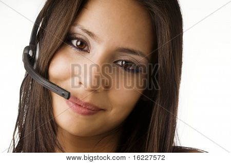 Attractive friendly customer service representative at work answering phone calls using a headset