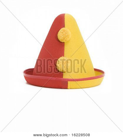 A yellow and red clown hat isolated against white background