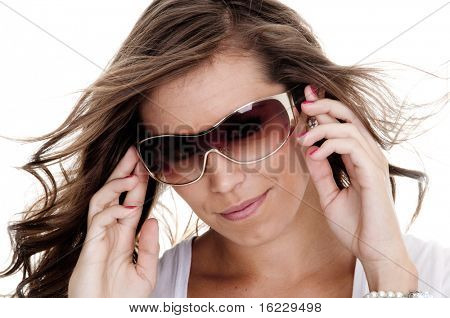 Isolated photo of young attractive woman wearing shades.