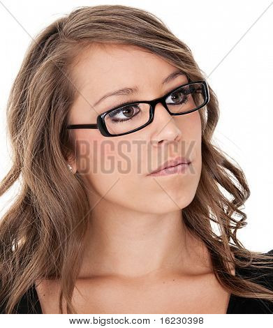 Portrait of a pretty young woman wearing glasses looking to up and to side
