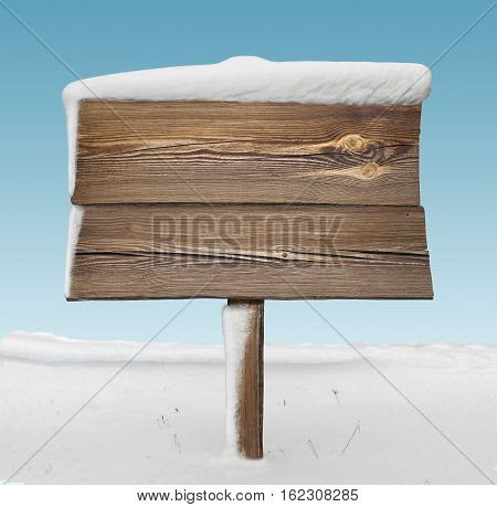 Wooden Signpost With Less Snow And Blue Sky