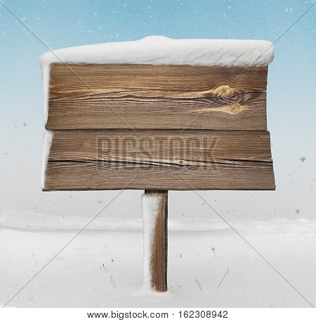 Wooden Signpost With Less Snow On It And Snowfall