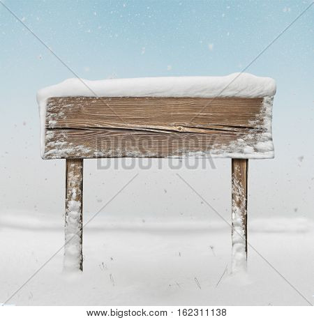 Wide Wooden  Signpost With Snow On It And Snowfall