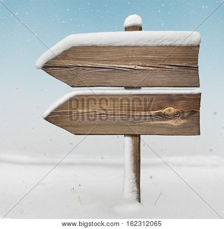 Wooden Direction Sign With Less Snow And Snowfall Bg. Two_arrows-one_direction