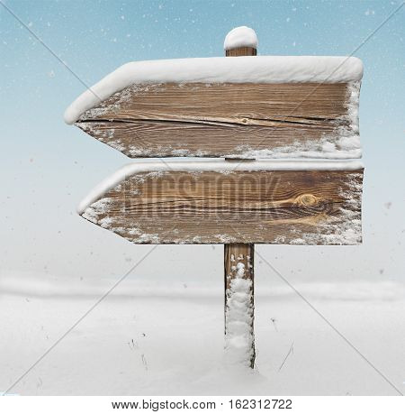 Wooden Direction Sign With Snow And Snowfall Bg. Two_arrows-one_direction