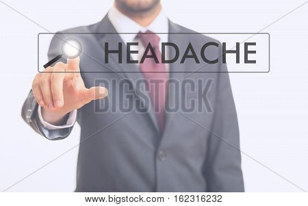 Man Pointing At Word Headache