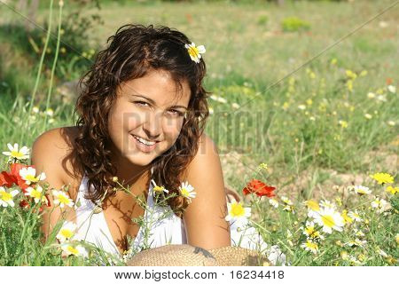 Girl laying in meadow of flowers