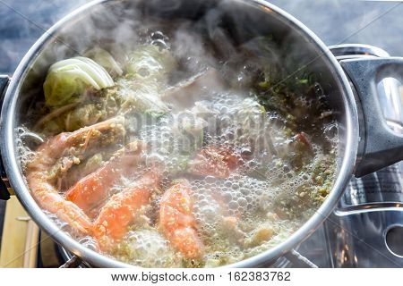 Seafood spicy hot pot crab prawn fish squid tumyum