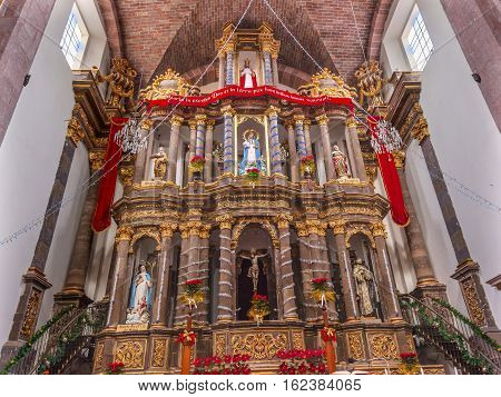 SAN MIGUEL DE ALLENDE, MEXICO - DECEMBER 28, 2014 Altar Basilica Christmas Convent Immaculate Conception The Nuns San Miguel de Allende Mexico. Convent of Immaculate Conception was created in 1754.