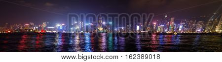 Hong Kong, China - January 1, 2016: Hong Kong panorama skyline with Central Plaza, Hong Kong Convention and Exhibition Centre, Bank of China, HSBC, Two International Finance Centre, Observation Wheel.