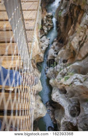 Trekking shoes on footbridge at Caminito del Rey path Malaga Spain