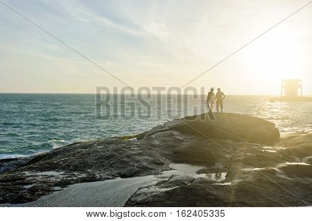 Two people on Indian Ocean coast in Kanyakumary the southernmost point of the Indian subcontinental Tamil Nadu India
