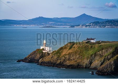 View of Howth Cliffs and Howth Head with the Baily Lighthouse and the Irish sea in the background in Ireland