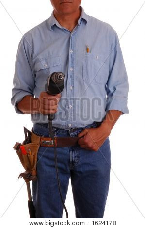 Carpenter In Toolbelt Holding Drill