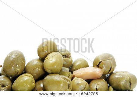 lot of black olives on awhite background