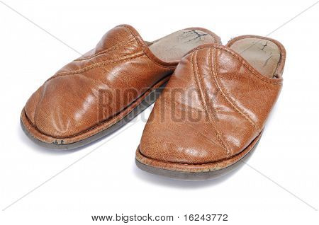 a pair of brown slippers for man isolated on a white background