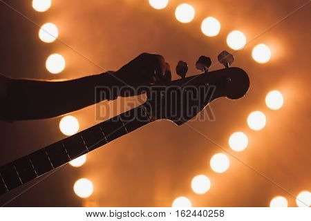 Guitarist Tunes Electric Bass Guitar