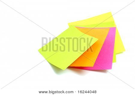 some post-it notes of different colors on a white background