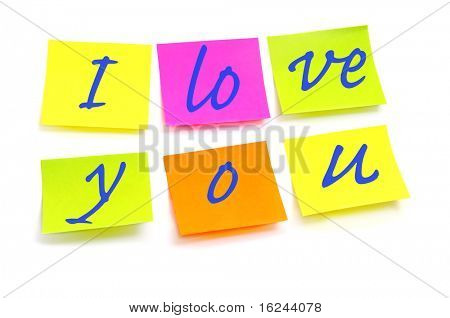 I love you written on post-its of different colors on a white background