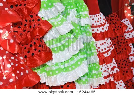 a pile of different flamenco dresses, typical of Spain