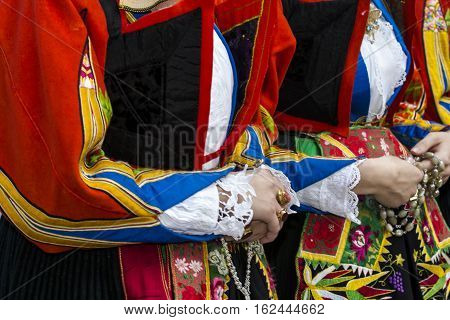 CAGLIARI, ITALY - May 1, 2016: 360 ^ Sant'Efisio Festival - Sardinia - detail of a female traditional Sardinian costumes