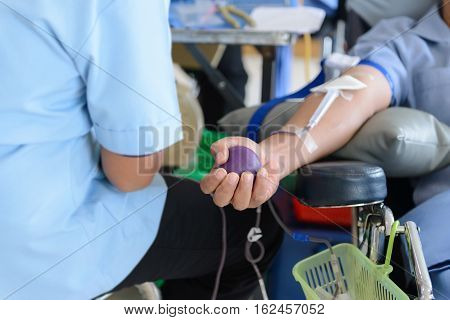 Blood Donor Male Holding Rubber Ball In Hand, Blood Donation, Squeezing A Bouncy Ball