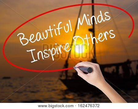 Woman Hand Writing Beautiful Minds Inspire Others With A Marker Over Transparent Board