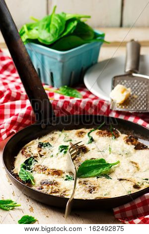 Spinach and Mushroom Egg White Frittata.Style rustic.selective focus