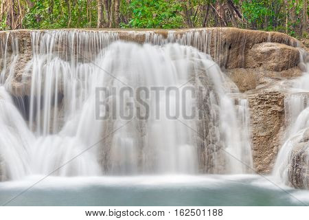 Natural flowing texture of waterfall cascades in Thailand Erawan National Park.